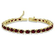 Oval-cut 6X4mm Created Ruby Tennis Bracelet in Gold Plated Sterling Silver