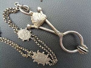 Victorian skirt lifter and chain.