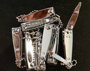 Lot of 12 TRIM Nail Clippers with File and Chain