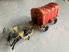 New ListingVintage Plastic Covered Wagon Coin Bank with Horses