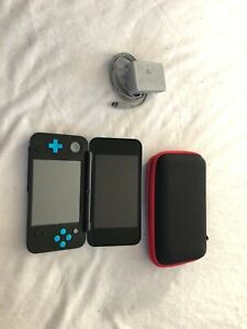 Nintendo 2DS XL. Comes with stylus and charger! Tested and works great :)