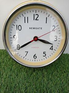 Yellow enamel on metal Newgate London wall clock