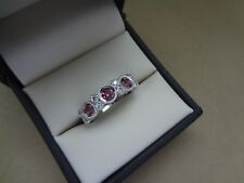 LOVELY 14K WHITE GOLD BEZEL-SET ROUND PINK TOPAZ AND DIAMOND EAST WEST RING