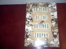 60 Years of the Outland Trophy Autographed by Chad Hennings and Russell Maryland