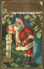Christmas - Santa Claus Lights Pipe by Candle Flame c1910 Postcard