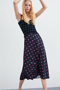 cherrie424: NWT Zara Polka Midi Skirt