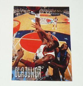 HAKEEM OLAJUWON HOUSTON ROCKETS 1996-1997 NBA BASKETBALL FLEER CARD