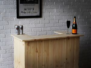The Compact Martini Home Bar in Solid Pine with stainless steel foot rail