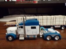 1/64 dcp peterbilt 379 Blue/White with step deck & pipe load