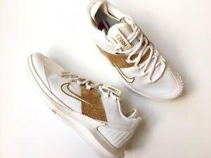 zapatos nike dorados