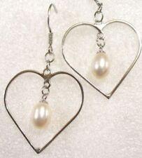 Orecchini di bigiotteria perle bianche a cuore