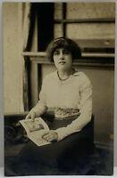 RPPC Pretty Edwardian Era Lady Sitting Posing with Photo Album Postcard C1900s