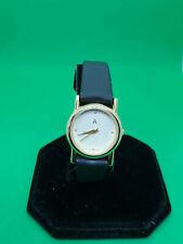 ladies avon 101  gold tone dress watch,ivory face,gold hands,black strap.b4.