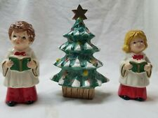 Christmas tree and choir people, tree 5 inches high.