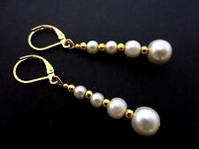 A PAIR OF DANGLY IVORY GLASS PEARL  GOLD PLATED LEVERBACK HOOK EARRINGS.