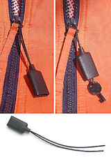 ZIPPER-PULL HANDCUFF KEY NOW WITH KEVLAR CORD Handcuff key in a zipper pull