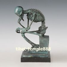 West art deco bronze man of powerful build In agony thinker skeleton sculpture