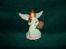 Angel Holding Harp And Basket Of Poinsettias Christmas Ornament 1993