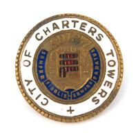 .RARE EARLY 1900s CITY OF CHARTERS TOWERS ENAMEL BADGE.