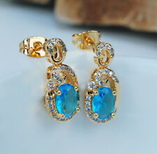 Damen Ohrringen anziehende Ohrringe vergoldet Gold 18K/750  blaue Topas