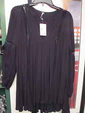 Adorable angel wing effect top by Free People,Black combo,size XS,sold at $108.