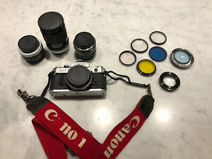 canon ae-1 35 mm film camera with 135, 50 and 28mm lenses + accessories