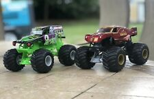 Hot Wheels Monster Jam 1:24 Scale Lot Of 2 Trucks Grave Digger And Iron Man