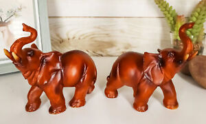 Ebros Faux Wood Feng Shui Elephant with Trunk Up Statue Set of 2