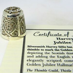 THIMBLE GUILD, 'JUBILEE THIMBLE' DESIGNED BY HARVEY SILLIS IN SOLID SILVER