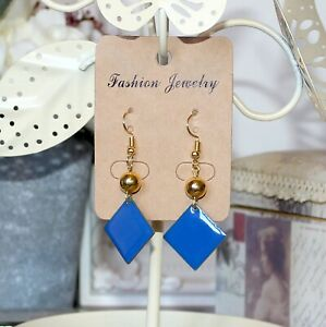Geometric style gold drop earrings with blue enamel square charms and gold beads