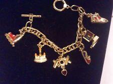 K.I.S. / KIS Goldtone 6 Charm Bracelet BRAT-A-TUDES