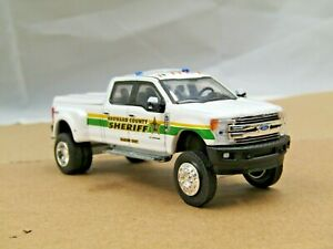 dcp/greenlight dually Custom lifted white Ford F350 pickup truck 1/64.