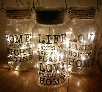 Glass jar with lights. Rustic distressed effect rope. Pretty slogan. Cute lights