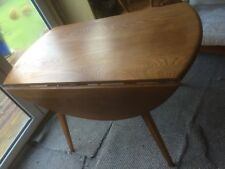 Ercol dining suite - 4 ft round table and four chairs