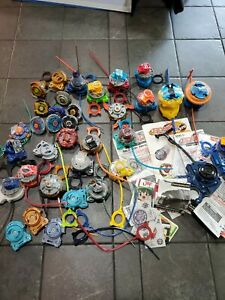 2010 2011 HUGE LOT BEYBLADE ITEMS, RIP CORDS, LAUNCHERS, METAL PLASTIC PIECES