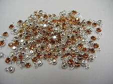 100 swarovski rhinestone 1-loop drops in 4mm topaz/sterling plate