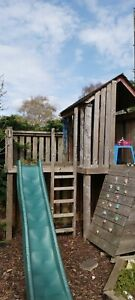 Wooden Bespoke tree house/climbing Frame With Climbing Wall And Slide