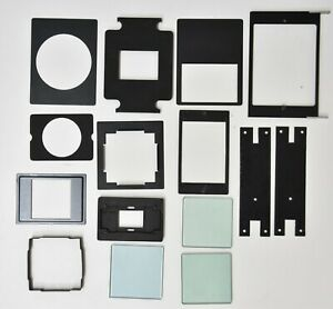 Set 15 different enlarger LEITZ Philips Rollei negative masks holders & glasses