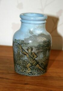 SMALL VINTAGE  UNMARKED VASE DEPICTING ANCIENT HUNTING SCENES.