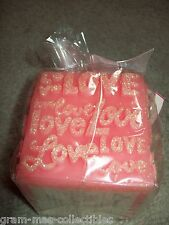 "DECORATIVE CANDLE A PINK COLOR SAYS """"LOVE"""" ALL OVER 3""X3""X3"" (7.6X 7.6X 7.6CM)"