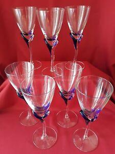 7 wine glasses w/ cobalt blue 1/2 of flower stem on glasses Excellent Condition