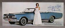1965 OLDSMOBILE STARFIRE & MISS AMERICA color photo promotional postcard UNUSED