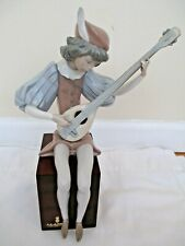 Retired Lladro Figurine Boy Sitting on Square base playing guitar instrument