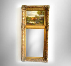 Tall beveled glass wall mirror in gold wood frame - cow painting on board
