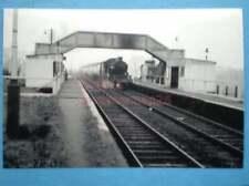 PHOTO  CASTLE BAR PARK HALT RAILWAY STATION  2/3/58 WITH 5002 STORMING THROUGH
