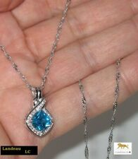 8.4 ct  SWISS BLUE  PAVED WHITE STONES SILVER PENDANT