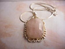 Silvertone chain necklace with a real rose quartz pendant..