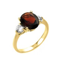 2.0 CTW Oval Garnet Three Stone Engagement Ring in Yellow Gold