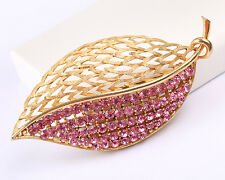 Beautiful Gold Tone Pink Rhinestone Brooch, signed J J, Vintage 1960s