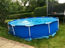 Intex Swimming Pool 12foot x 30inches includes pump, heater, covers...